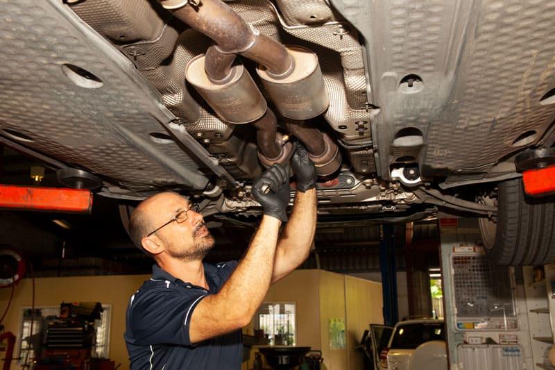 vehicle repair mechanic providing sunshine coast car exhaust repairs underneath vehicle