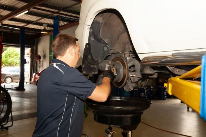 mechanic working on brake repairs sunshine coast