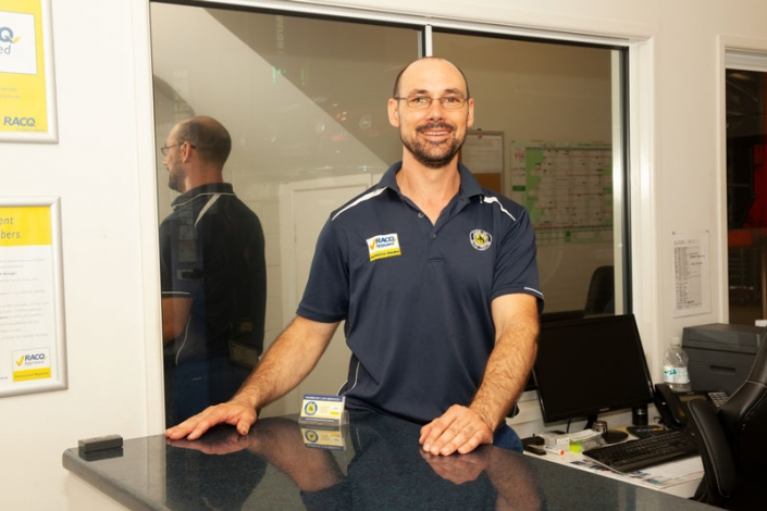 Nambour car mechanic standing behind counter