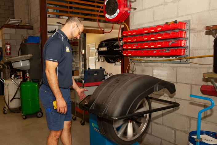 nambour tyre mechanic checking tyre pressure of detached tyre to do wheel balancing wheel alignment