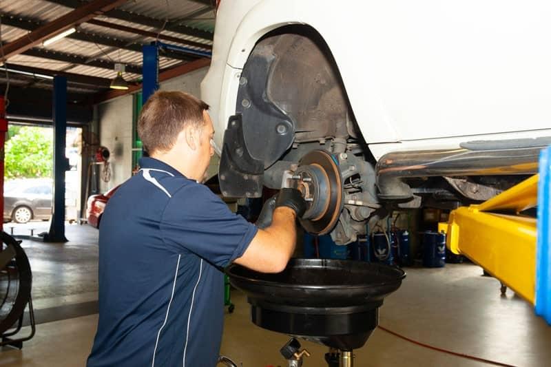 mechanic doing brake repairs sunshine coast